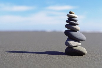 Stacked Stones on Sand --- Image by © Tim McGuire/CORBIS